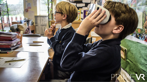 Child in class using VR headset